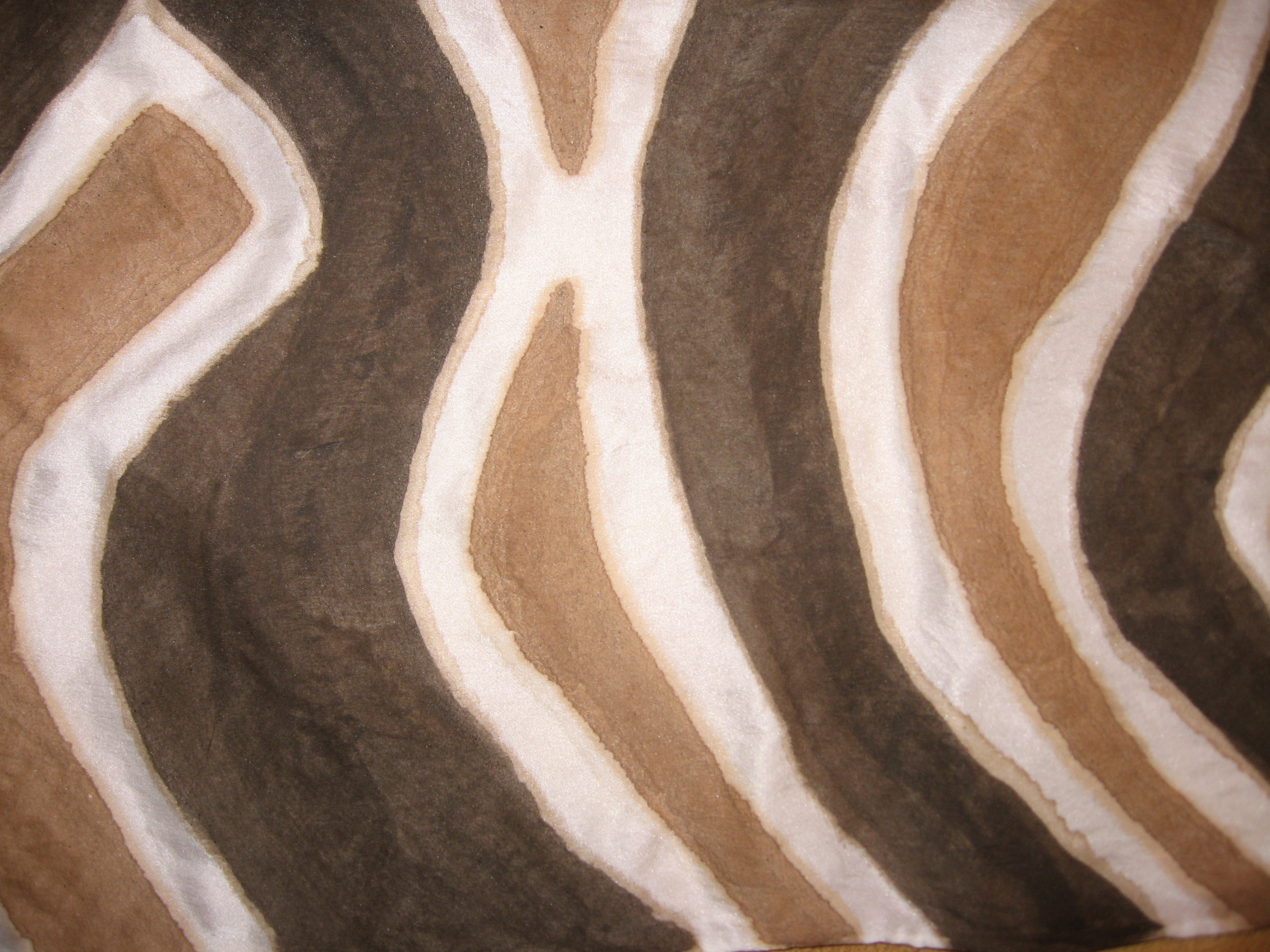 black and brown mud on silk